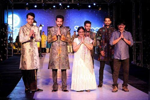 sharbari datta and her son in a fashion show